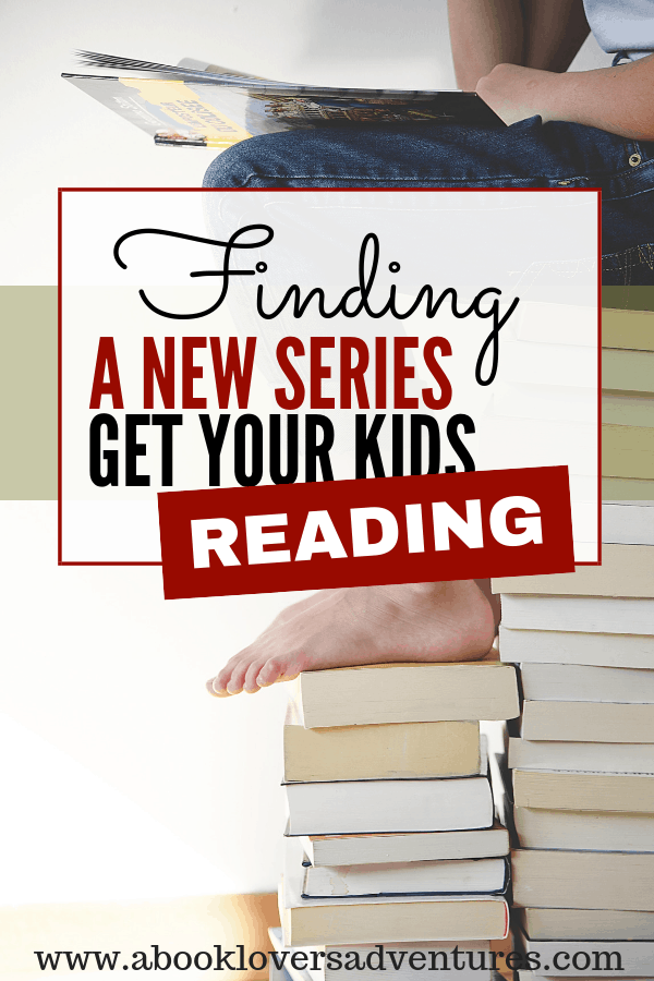 kid sitting on a stack of books - helping your child find a great new series