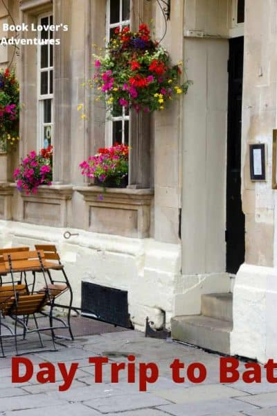 White building with colorful flowers and wording: A Day Trip to Bath