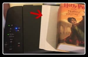image shows printer with stock paper and Harry Potter book, ready to copy pages for a book lover ornament