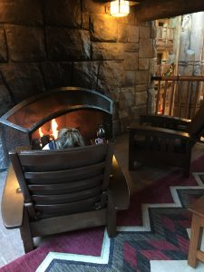 sitting in front of one of the fireplaces at the Wilderness Lodge