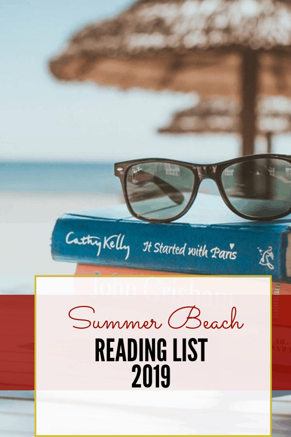 books and sunglasses under a tiki hut, ready for summer reading