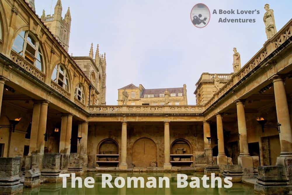 The Roman Baths pool with the pillars around the edges; good to visit on your Day Trip to Bath