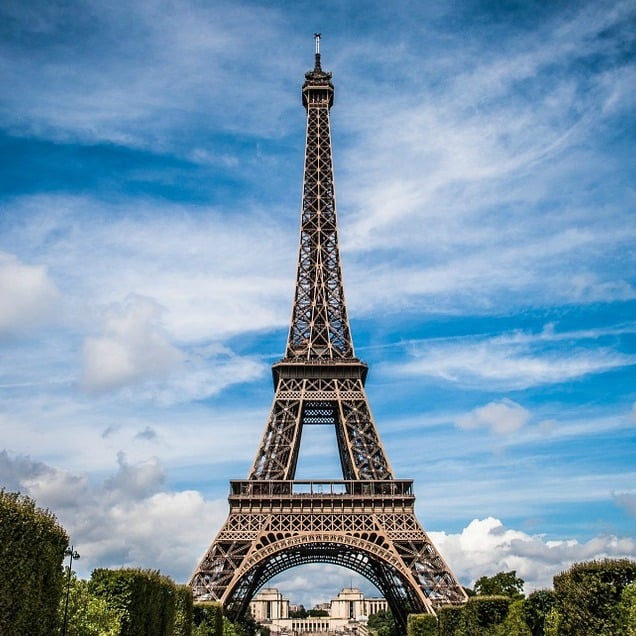 Eiffel Tower with a cloudy blue sky in the background - books set in France