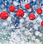 background image of red ornaments hanging in front of a snowy backdrop